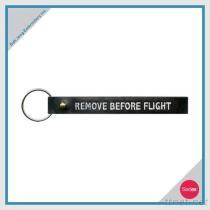 자수 열쇠 고리 - 비행의 앞에 제거하십시오
